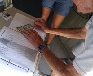 Bob Signing the 2 dollar bill for the fifth year in a row after his climb at 90